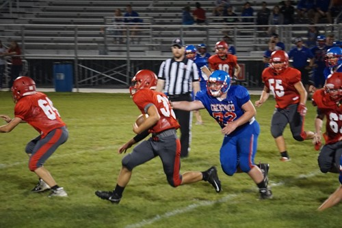 A Van Wert football player runs the ball against Crestview