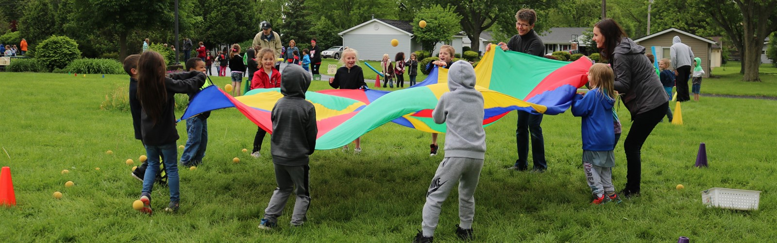 ECC students playing with a parachute during field day