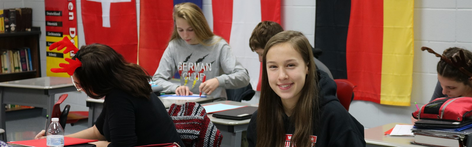 Students writing letters in German class