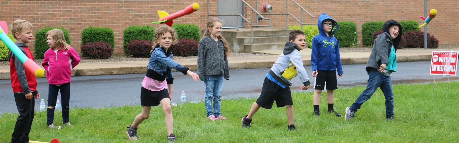 ECC students throwing foam rockets during field day