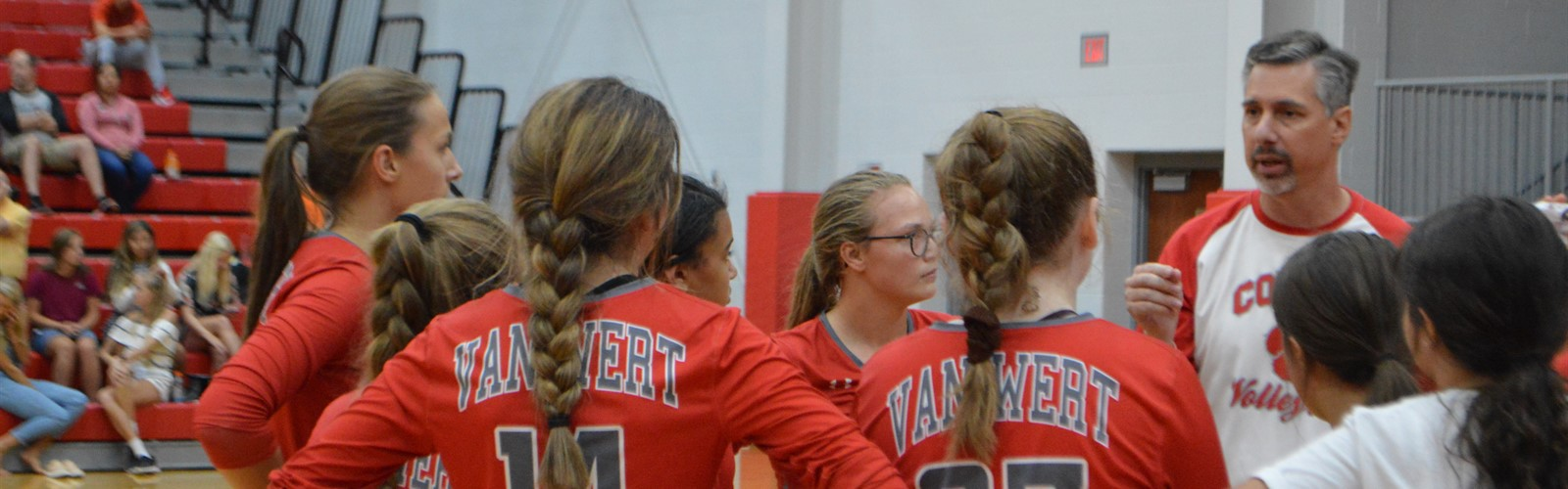Van Wert junior varsity volleyball athletes receive advice from Coach Krites.