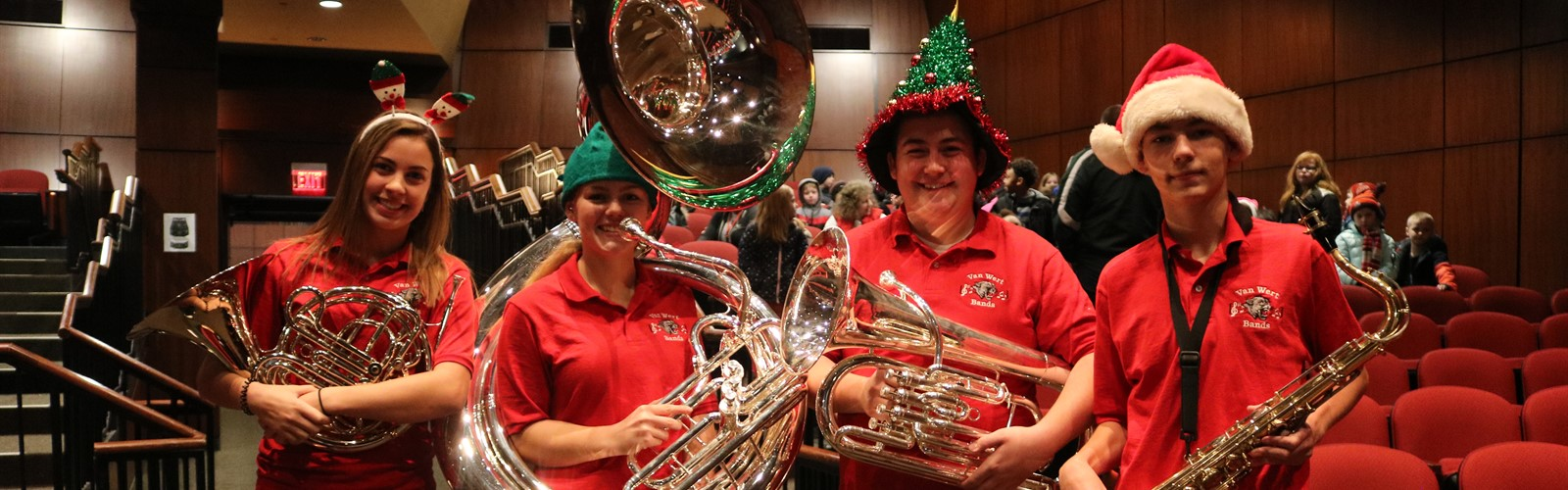 High school students pose with their instruments after the Kiddie Christmas Concert