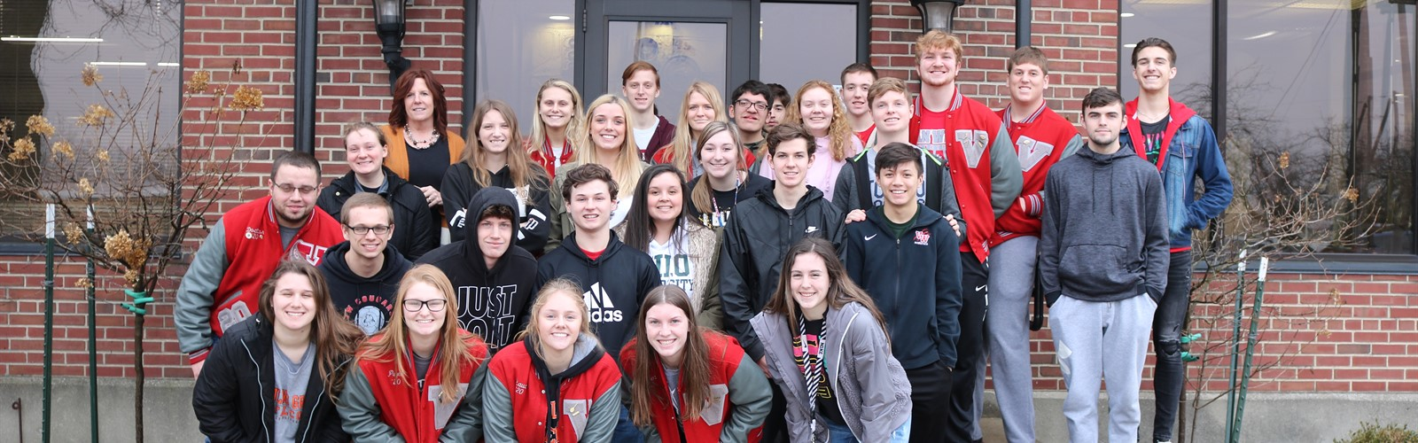 A group of VWHS seniors pose outside of Fedral Mogul during Senior Business Tour day