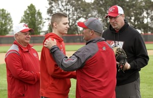 St. Henry sophomore Nate Niekamp, middle left, shakes hands with Van Wert baseball coach Charlie Witten