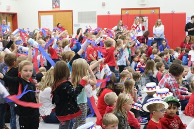 Students wave streamers during the Veterans Day assembly
